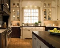 off center kitchen sink... i might have to do this.  it looks nice here!!