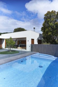 Architecture:Amusing Exterior Home Design With A Big Rectangle Swimming Pool With Between High Grey Fence And Glass Partition On The Tile Fl...