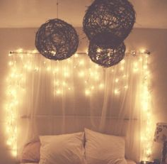 love the lights and sheer material around the bed