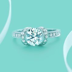 Ribbon engagement ring with a round brilliant diamond. #TiffanyPinterest