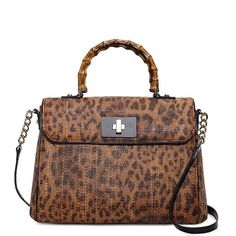 """As if the combination of the name """"Kate Spade"""" and the word """"tiki"""" wasn t  enough to get my attention, the Kate Spade Tiki Little Nadine is  leopard-print to ... 53c06793d67"""