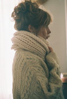 Oversized sweater, cozy knit scarf and pretty loose updo of curls. Perfection.
