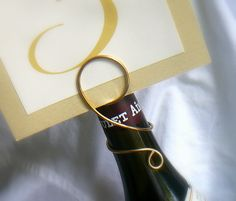 Wine Bottle Number Holder for Wedding Reception, Wine Events, Wine Themed Showers, 5. $30.00, via Etsy.
