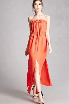 A woven maxi dress featuring a strapless design, a ruffled elasticized neckline and waist with a bow-front accent, and front slit details. This is an independent brand and not a Forever 21 branded item.