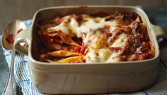 Cheesy pasta shells with a simple tomato sauce, baked until crisp, golden and gooey.