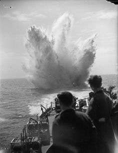 ROYAL NAVY DURING SECOND WORLD WAR OPERATION OVERLORD NORMANDY LANDINGS JUNE 1944 (A 23959) HMS HOLMES drops a depth charge on a suspected U-boat during the landing operations on the Normandy coast.