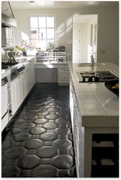 painted floor tiles with a resin/epoxy mixture; save money by not having to rip up tiles Click to check a cool blog!Source for the post: Click