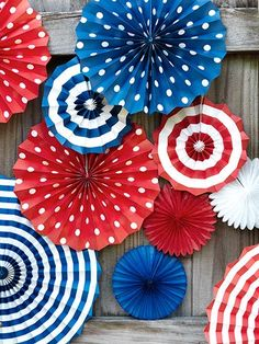 Paper fans add a patriotic touch to porch railings and fences. ##fourthofjuly (Photo by: Jonny Valiant)