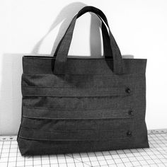 WhitneyJude Etsy shop Customizable Large Tote Bag.  Maybe ask about longer reinforced straps for carrying hymnals