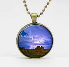 """Desert Lightning Storm Utah Art Glass Pendant or Key Chain- 30 mm round- Chain Included- Made to Order. This image is set in a 30 mm bezel and comes complete with a 24"""" matching chain or matching key chain. Please choose from silver, copper, or bronze for the bezel and chain color. Please choose from a link chain, ball chain or key chain. This listing is for the glass art pendant and 24"""" chain, or pendant and key chain. My glass art pendants are handcrafted using a high quality pendant..."""