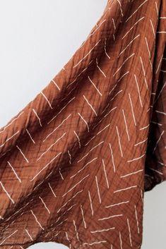 Rust Mudcloth Muslin Swaddle Blanket