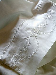 Recipe to Clean Sheets:   Pinner was  given a washing recipe for sheets by the sales associate at Macy's:  1 1/2 c cheap white vinegar  1 T detergent  Warm wash  Warm rinse  Extra rinse  Perma-press dry  Apparently, this recipe was developed by an 84-year-old woman who really knew her sheets.  The lady said that drying them on permanent press is cooler and keeps the fibers smoother and softer?