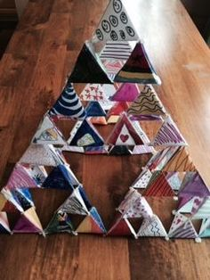 This is a great class activity - each student creates a triangle (or several) and then you build Sierpenski's triangle.  A good accompaniment for teaching fractals.
