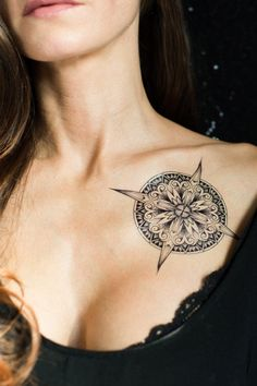 Compass temporary tattoo by Sasha Masiuk. https://www.tattooyou.com/product/two-flowers/