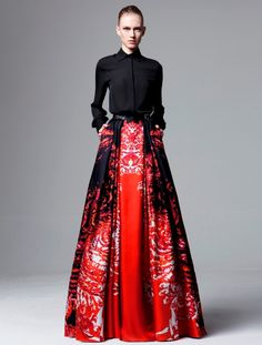 Red fit and flare dress with a black sweater or button down over top Zuhair Muhad