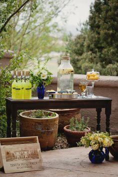 This is something that your caterer should totally set up. A lemonade/limoncello stand where the ceremony will take place.
