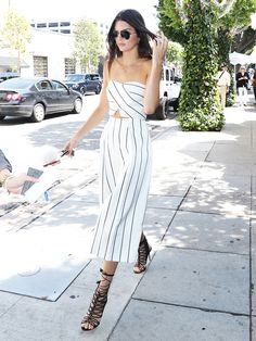 Kendall Jenner in a matching striped set and strappy sandals