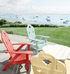 The Adirondack Chairs on the terrace allude to the summer colors you find inside this seaside summer home...