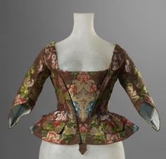 Casaquin, France, 1730-1750, fabric: c. 1720-1730. Brown sil brocaded with floral and ornamental motifs in multicoloured silk and metallic threads.