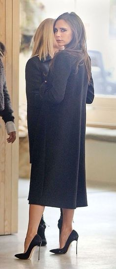 Victoria Beckham. Casadei heels // girl crush //long black wool coat //AW15                                                                                                                                                     More