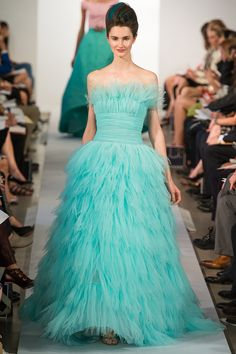 Oscar De La Renta spring 2013 collection turquoise gown it transports you to fairy land. Instantaneously you step into the lovely froth of femininity.