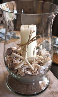 Large glass hurricane from Goodwill filled with sand, shells and a candle