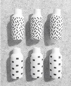 The Bottle Vase in two hand painted patterns : The Granite