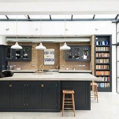 Sleek concrete worktops and floors, beautiful big metal frame windows and simple Shaker cupboards look too beautiful in our Balham kitchen. #deVOLKitchens