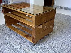 Cute pallet coffee table, stained with a glass top and silver legs added.