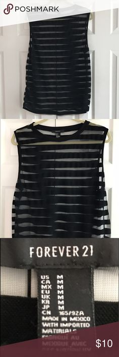 """Forever 21 top or swim cover-up Tag for size, fabric in care posted. Color is black with the sheer leading striped. Netting is completely see-through. Could be used as the tank or a swimsuit cover-up. Netting has several very small snags. Very hard to see   Photo 6 shows a small snag. (Back lower left). Armpit to armpit 22"""". Shoulder to bottom hem 28"""". Gently washed and worn with no stains. No trades and please use offer button. Forever 21 Tops Tank Tops"""
