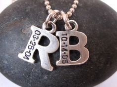 hand-stamped jewelry w/ babies first initial & date of birth.