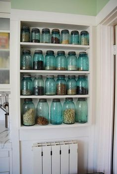 Vintage Ball mason jars for storage on open kitchen cupboard shelves.  So…