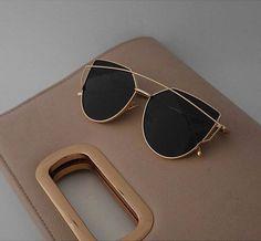 ff1db9d8baa London Sunglasses Black. A Vanity Affair