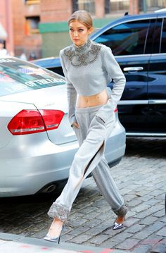 Whether or not she's on the job is unclear (yes, Gigi Hadid always looks that good). Either way, we need this crystal-encrusted gray matching set in our lives, stat.