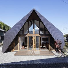 Japanese studio TSC Architects modelled the roof of this house in Japan's Mie Prefecture on the folded paper shapes of origami.