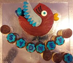 "- Bird shaped birthday cake and smash cake on cupcake/mini cupcake ""branch"""