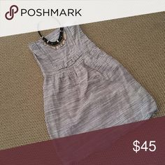 Strapless linen dress with POCKETS Cream, tan and grey patterned linen/cotton blend fabric.  Corset style top with flexible boning. Invisible back zipper. Hidden pockets in the fully lined skirt.  Excellent used condition. I am open to offers and love to discount on bundles.  Total length is 30 inches, 20 inches from waist to hem.  Waist is 14.5 across. Banana Republic Dresses Strapless