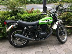 We took this Kawasaki 250R photo in Japan. A good motor was in the street. #kawasaki250r #kawasakimotor #spokes #streetmotorcycle