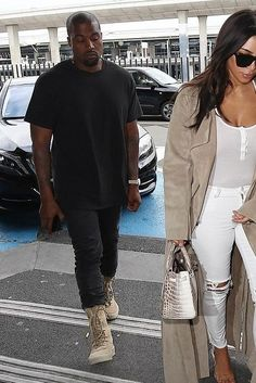 Kanye West wearing Acne Studios Ace Used Cash Slim-Fit Jeans and Yeezy Season 2 Taupe Crepe Boots