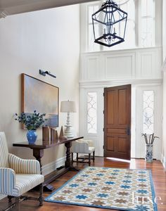 Traditional White Entry Hall with High Ceiling