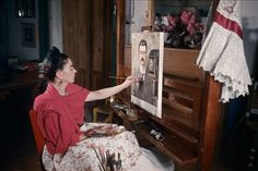 "Frida Kahlo in her studio painting ""Portrait of My Father"".   Photos of Kahlo and husband Diego Rivera from German-born French photographer Gisèle Freund."