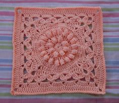Here is another stunning design by Melinda Miller. I fell in love at first sight with this square, the cute bobbles and the great firm-but-soft texture. The lovely Crown Jewels pattern by Melinda Miller is intended for a 12-inch square. If you don't know yet, you'll get to learn the popcorn stitch and dtr stitch. …
