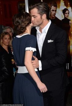 Smooch! Chris Pine and co-star Keira Knightley shared a kiss at the TCL Chinese Theatre premiere of Jack Ryan: Shadow Recruit in Los Angeles...