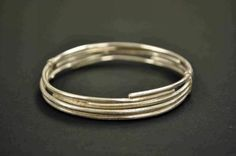 """""""Jewellery is much more satisfying to me than other medium…I am drawn to clean, simple shapes with a twist. Simple Shapes, Sterling Silver Bracelets, Handcrafted Jewelry, Bangles, Detail, Artwork, Handmade Chain Jewelry, Bracelets, Handmade Jewelry"""