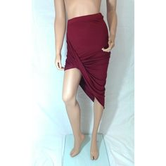 Burgundy Asymmetrical Draped Skirt #008-BUS Stretchy fabric that is higher on one side and drapes across. 95% rayon 5% spandex. Skirts