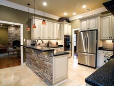 Dramatic stone echoes the stone fireplace beyond - plan 055S-0104 - houseplansandmore.com