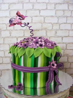 Green and Violet cake  with colorful butterfly