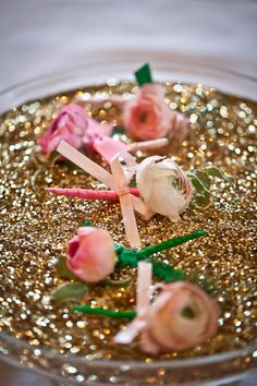 such a cute boutonniere pic. pink, green, gold glitter. what could be better?