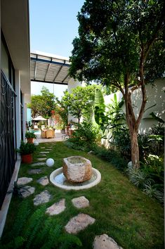 Beautiful garden with a rock pathway and water feature at its heart