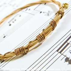 guitar string bracelet, I've done this and its super easy! works best with 13.5 sizes and E + B